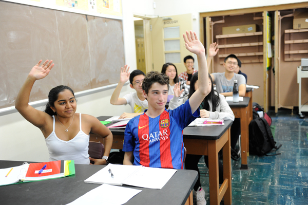 Students in Class Raising Hands