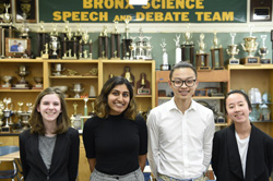 Four debate students posing for the camera